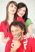 Three Portuguese football supporters — Stock Photo