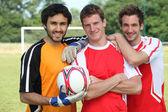 Football teammates posing — Stock Photo