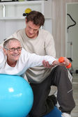 Physiotherapist and mature patient — Stock Photo