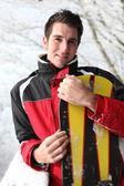 Man holding his snowboard — Stock Photo