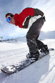 Adrenaline junkie snowboard down hill — Stock Photo