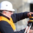 Surveyor with equipment - Stock Photo