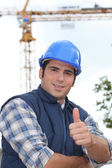 A construction worker giving the thumb up. — Stock Photo