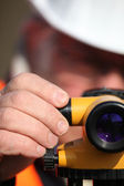 Civil engineer adjusting a theodolite — Stock Photo