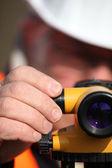 Civil engineer adjusting a theodolite — Stock Photo