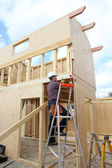 Construction worker building a house — Stock Photo