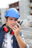 Construction worker with radio — Stock Photo