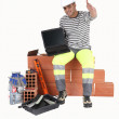 Stock Photo: Builder with laptop showing blank screen