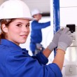 Young female electrician wiring a building — Stock Photo