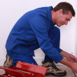Stock Photo: Plumber measuring pipe work