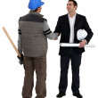 Architect shaking laborer's hand — Stock Photo