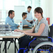 Woman in wheelchair with laptop computer — Stock Photo #7779362