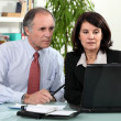 Couple working together on laptop — Stock Photo #7779433