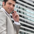 Young man setting an appointment on phone — Stock Photo