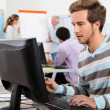 Young man working at a computer — Stock Photo #7779866