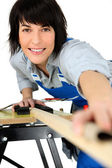 Female carpenter using workbench — Stock Photo
