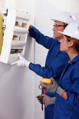 Electrical team installing a fusebox — Stock Photo