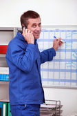 Man marking calendar — Stock Photo