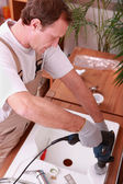 Handyman installing a sink — Stock Photo