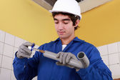 Portrait of a young plumber — Stock Photo