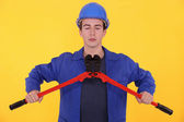 Builder using bolt cutters — Stock Photo