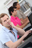 Male students in class working on laptop — Stock Photo