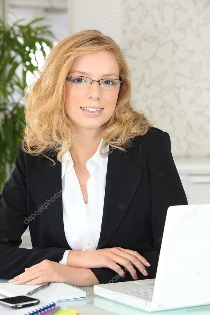 Young businesswoman working in her office — Stock Photo #7779165