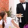 Stock Photo: Waiter serving a table
