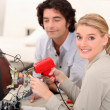 Woman soldering television - Stock Photo