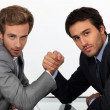 Stock Photo: Two young men well dressed doing arm-wrest