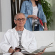 Stockfoto: Young womassisting elderly lady