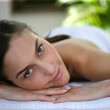 Pretty girl lying on massage table — Stock Photo #7781461