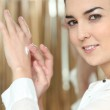 Young woman applying hand cream — Stock Photo #7781470