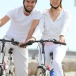 Stock Photo: Friends having bike ride