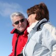 Mature couple in winter coats — Stock Photo #7782099