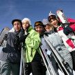 A group of friends on a skiing holiday — Stockfoto