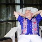 Senior relaxing on the veranda — Stock Photo #7782168