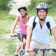 Couple enjoying bike ride — Stock Photo #7782485