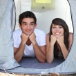 Teenagers in a tent — Stock Photo