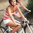 Portrait of 2 girls on bikes — Stock Photo