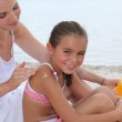 Mother and child at the beach — Stock Photo
