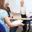 Teacher stood at the front of the classroom — Stock Photo