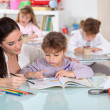 Teacher with thee young pupils — Stock Photo #7783078