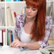 Stock Photo: Girl studying in the library