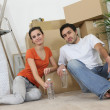 Couple sitting inside apartment — Stock Photo #7783268