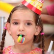 Stock Photo: Young girl at child's birthday party