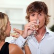 Young couple drinking champagne at Christmas — Stock Photo