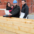 Architect with young family at construction site — Stock Photo
