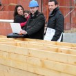Architect with young family at construction site - Stok fotoğraf