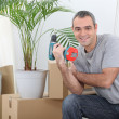 Man packing boxes for house move — Stock Photo